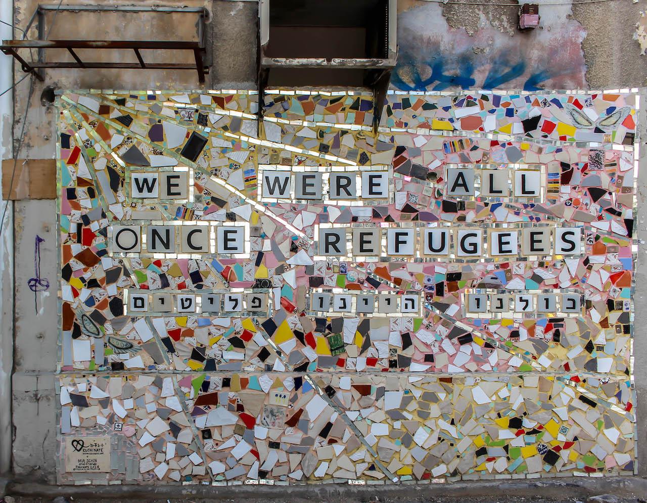 "Bild ""we were all once refugees"" in Tel Aviv."
